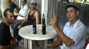 La Bălăciţa, ajutorul social e aşteptat de unii localnici cu berea în faţă, la birtul din comună