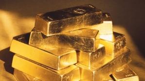 Preţul aurului a atins luni un nou nivel istoric