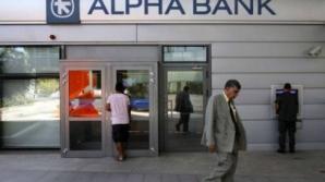 Alpha Bank a restricţionat tranzacţiile.