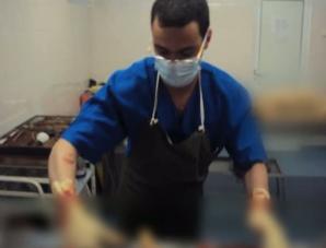Medic rezident, şedinţă foto la morgă