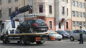 Hingherii de maşini au ridicat maşina Poliţiei