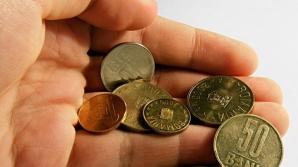 Revoltată, femeia a hotărât să plătească amenda cu monede de 1 ban, 5 şi 10 bani.