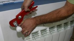 Obligat să plătească sistemul centralizat de încălzire, deşi are centrală