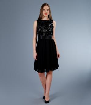 Rochia din tul elastic, negru, în valoare de 550 de lei îţi va sublinia silueta, iar paietele aplicate îţi vor da o strălucire aparte!