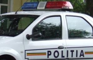 Incatusat, parintele a facut un adevarat spectacol in masina politiei