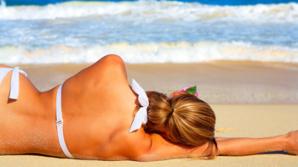 Cât ne recomandă medicii să stăm pe zi la soare? Excesul creşte riscul de cancer