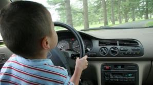 Copil de zece ani, prins la volanul unei maşini, pe o stradă din Sibiu