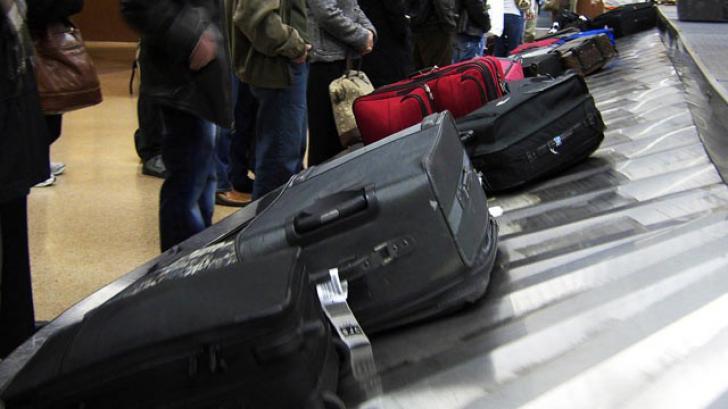Bagaje aeroport - imagine cu notă sugestivă