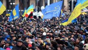 Ucraina: Merkel îi cere lui Ianukovici retragerea legilor contra manifestanților