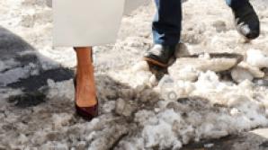Victoria Beckham, în pantofi stiletto prin zăpadă
