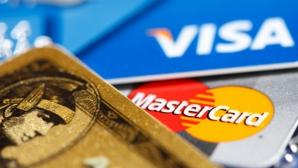 Visa şi MasterCard au oprit serviciile pentru clienţii băncilor ruseşti