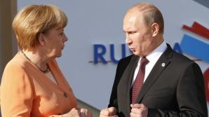 Cancelarul Germaniei, Angela Merkel, într-o discuţie cu preşedintele Rusiei, Vladimir Putin