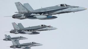 Aeronavele CF-18 Hornet ale alianței NATO ajung astăzi în România