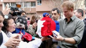 Prinţul Harry a reparat televizorul unei familii chiliene pentru ca aceasta să poată urmări CM