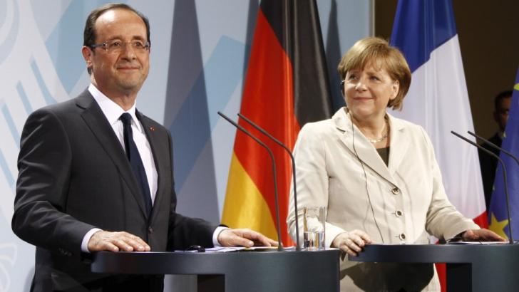 Parisul şi Berlinul îi îndeamnă pe Putin şi Poroşenko să coopereze pentru respectarea armistiţiului