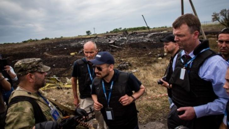 Trupurile pasagerilor zborului MH17 au ajuns în Olanda