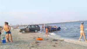 Ce face un cocalar cu jeep pe plaja de la Năvodari