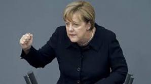 Angela Merkel surprinsă cu aceiaşi haină