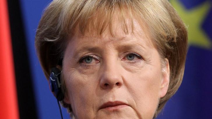 Merkel îi solicită lui Putin să facă uz de influența lui pe lângă rebelii proruși