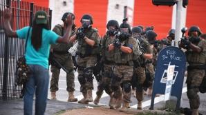 Nou incident în care un tânăr de culoare a fost împuşcat de un poliţist