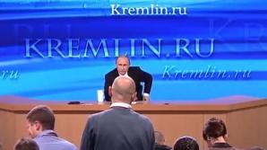 Preşedintele rus Vladimir Putin a glumit joi, în timpul conferinţei sale de presă anuale, pe seama unui jurnalist