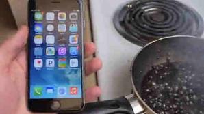 EXPERIMENT CIUDAT: Ce se întâmplă cu iPhone 6 când este fiert în Coca-Cola