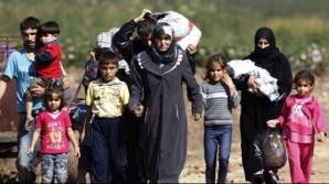 Slocavia va bloca prin veto cotele obligatorii de refugiaţi