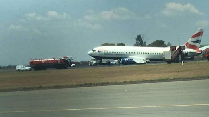 Accident aviatic. O aeronavă cu 100 de persoane la bord a luat foc şi s-a rupt la aterizare
