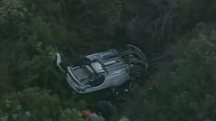 Au găsit mașina răsturnată, cu două trupuri în ea. Detaliul care i-a cutremurat pe polițiști