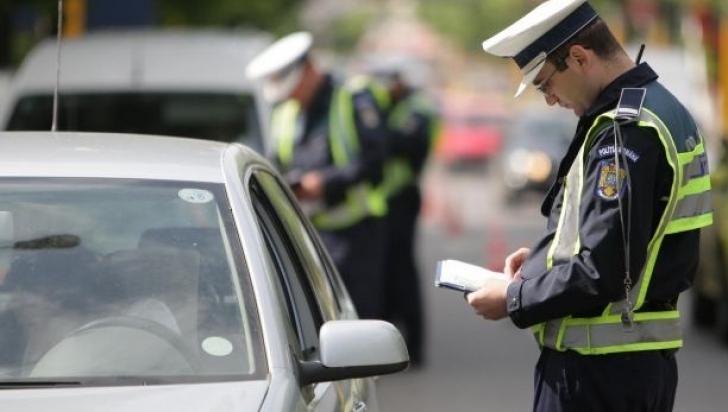 Un şofer din judeţul Dolj, oprit în trafic  focuri de armă de poliţişti