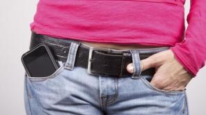 Renunţă să porţi telefonul mobil în buzunar! Poate fi mortal