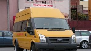 Şoferul unui microbuz şcolar, cercetat după ce a transportat oameni de la un miting electoral