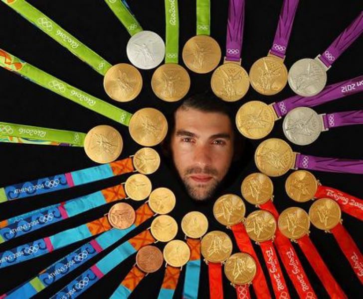 Michael Phelps şi-a expus pentru prima oară toate cele 28 de medalii olimpice într-un pictorial