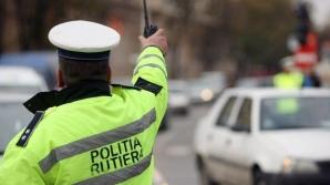 VIDEO: Bătaie în plină stradă între poliţişti şi un bărbat. Motivul: fiica agresorului