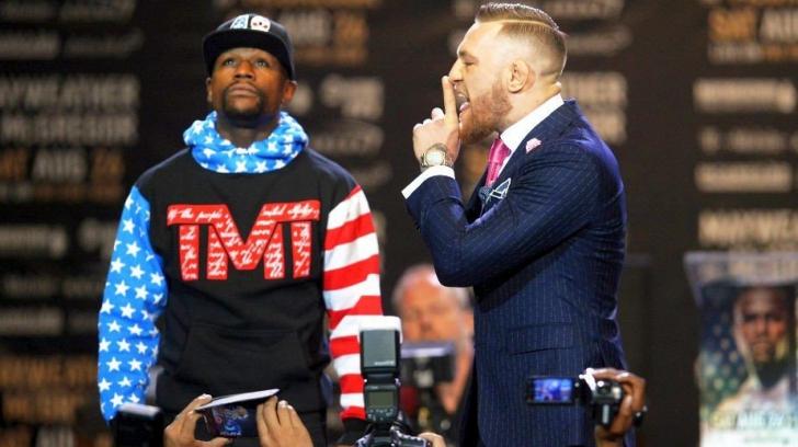 Mesajul obscen imprimat pe costumul lui Conor McGregor, la conferința de presă cu Floyd Mayweather!