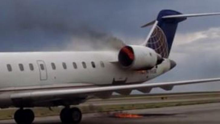 Un avion plin cu pasageri a luat foc la aterizare. Imagini șocante