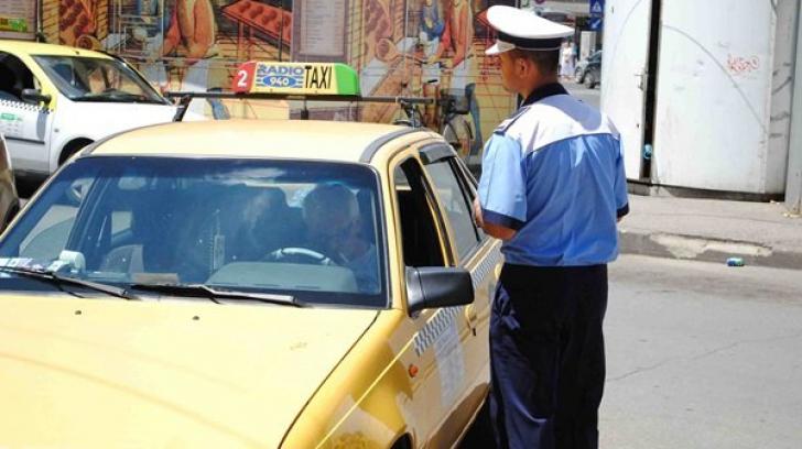 Şofer de taxi reţinut, după ce a furat telefonul unui client