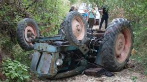 Bărbat strivit de propriul tractor.