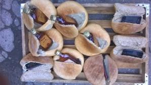 Alcool și telefoane, în pâinile trimise deținuților