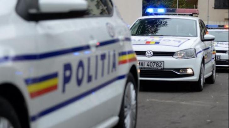 Scandal cu focuri de armă la Clejani. Două persoane, rănite