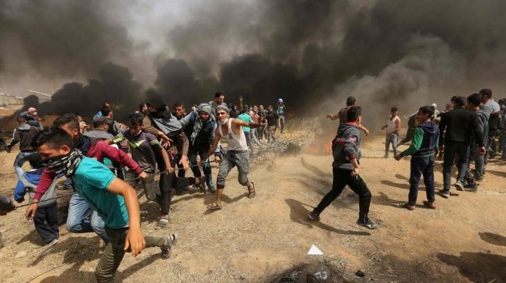 Peste o sută de palestinieni au fost răniţi în urma unor confruntări cu armata israeliană