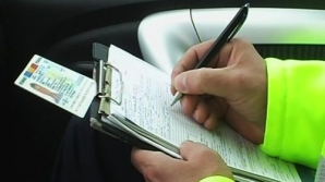 Legea care măreşte intervalul de plată a amenzilor de la două la 15 zile, promulgată de Iohannis