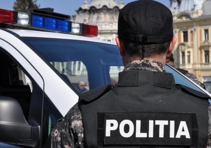 Politist agresat