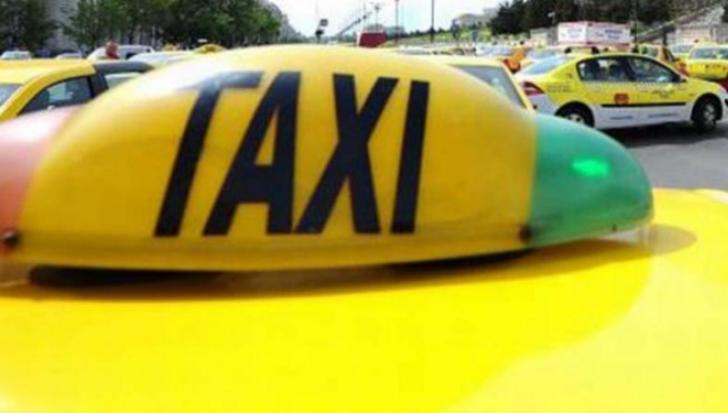 Taximetriştii ar putea fi amendaţi dacă nu sunt îmbrăcaţi... corespunzător