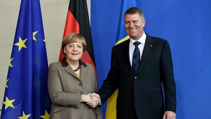 Retragerea lui Merkel, legătură cu Iohannis