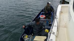 Intervenție periculoasă în Marea Neagra. Doi bărbați au fost salvați de Garda de Coastă