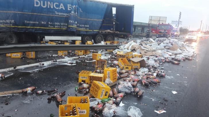 A1 spălată cu bere! Tone de alcool s-au scurs pe autostradă în urma unui accident