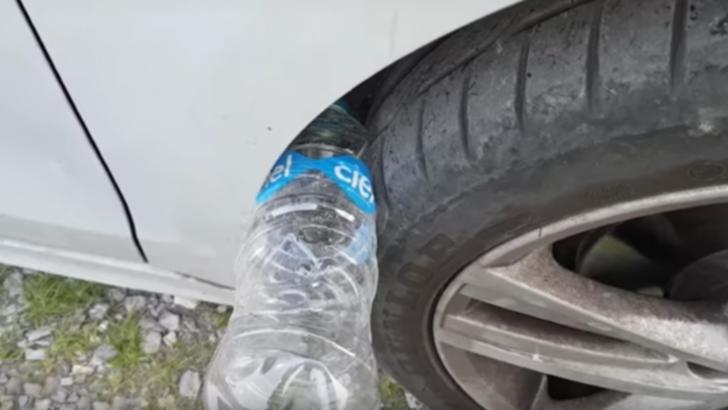 Ce se întâmplă dacă găsești o sticlă de apă la roata mașinii. Sună urgent la poliție!