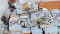 Captură URIAȘĂ de bani cash, descoperită la un traficant de droguri din Capitală. Banii proveneau din vânzarea dintr-o SINGURĂ săptămână!