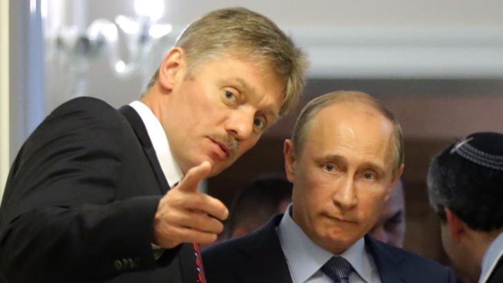 Vladimir Putin și Dmitri Peskov, purtător de cuvânt Kremlin